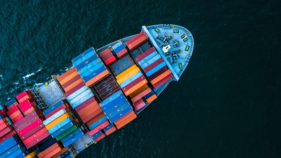 shutterstock_colourful container ship 708817909